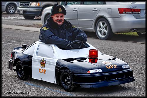 car police parade cayuga opp shriner ontarioprovincialpolice santaparade nikkor75240mm topazadjust