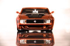 muscle car(0.0), model car(1.0), automobile(1.0), automotive exterior(1.0), boss 302 mustang(1.0), vehicle(1.0), stock car racing(1.0), automotive design(1.0), bumper(1.0), scale model(1.0), land vehicle(1.0), supercar(1.0), sports car(1.0),