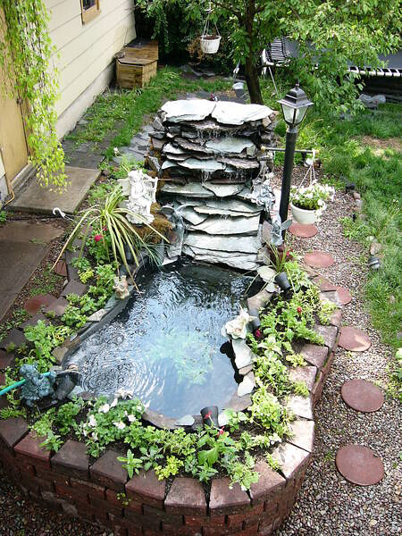 Outdoor above ground pond flickr photo sharing for Raised koi pond ideas