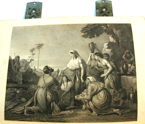 Rebecca at the Well; Eliezer, the servant of Abraham, presents Rebecca with betrothal jewels - the bride of Issac, Mesopotamia - old bible etching, 1885 by Wonderlane