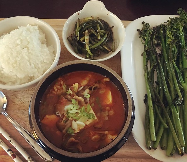 My dinner while Dollar's at band practice. Kimchi jjigae, sautéed garlic scapes and broccoli rabe (both from today's CSA pickup). 🍲