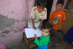 Marziya Teaches the Slum Kids to Write by firoze shakir photographerno1