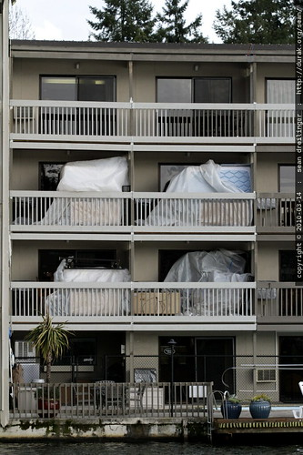 things that make you go 'hmm...'   local hotel with bagged mattresses on the balconies