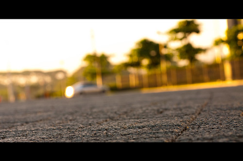 morninglight parkinglot bokeh depthoffield asphalt goldenlight nikkor50mmf14d ineedavacation nikond90 uptechnohub michaeljosh