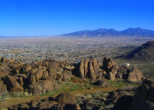 city blue arizona sky brown rock landscape town day boulder clear deset