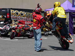 racing, sport venue, vehicle, race, motorcycle, motorsport, motorcycle racing, road racing, motorcycling, stunt performer, stunt,