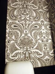 carving(0.0), textile(0.0), brown(0.0), iron(0.0), circle(0.0), flooring(0.0), art(1.0), pattern(1.0), design(1.0), drawing(1.0), wallpaper(1.0), paisley(1.0),