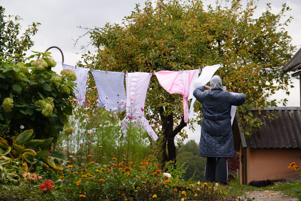 Woman Hanging Clothes in Trakai