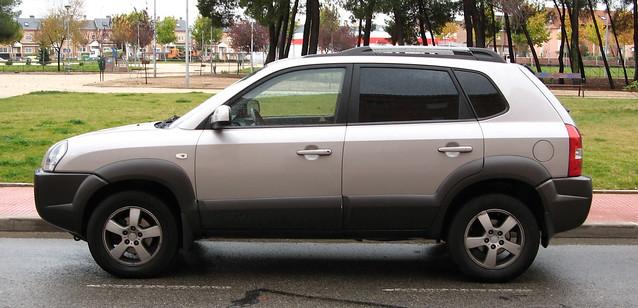 beige Hyundai driving