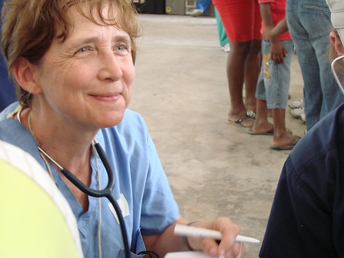 Nurse working with a patient