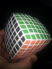 design(0.0), lighting(0.0), ball(0.0), hand(1.0), rubik's cube(1.0), light(1.0),