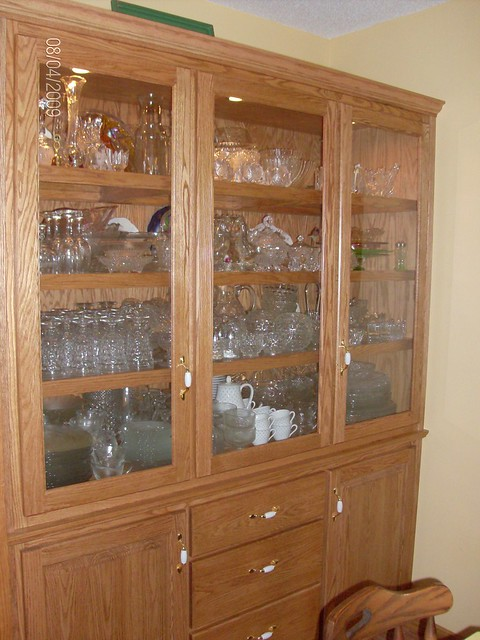 how to keep your plates from rolling in china cabinet