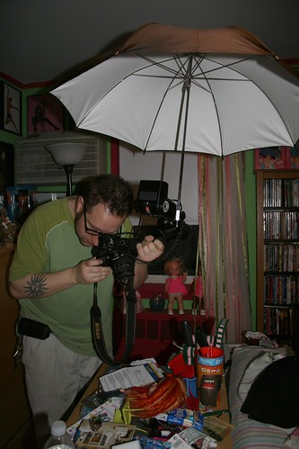 random old picture of ross photographing nonsense at my house. yes, he travels with this giant umbrella set up at times. just waiting for it to poke someone's eye out
