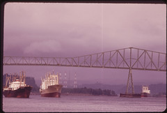 Cargo Ships and Bridge at Longview, Home of the Weyerhauser Company, One of the World's Largest Forest Operations 04/1973