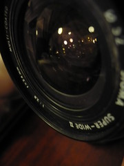 wheel(0.0), eye(0.0), cameras & optics(1.0), digital camera(1.0), camera(1.0), teleconverter(1.0), lens(1.0), digital slr(1.0), fisheye lens(1.0), close-up(1.0), camera lens(1.0), black(1.0), reflex camera(1.0),