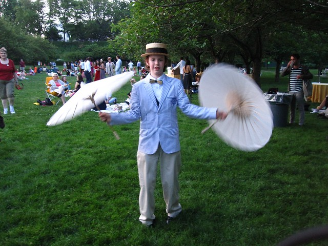 A young guest enjoys some parasol spinning on Cherry Esplanade during BBG Members' Centennial Evening. Photo by Rebecca Bullene.
