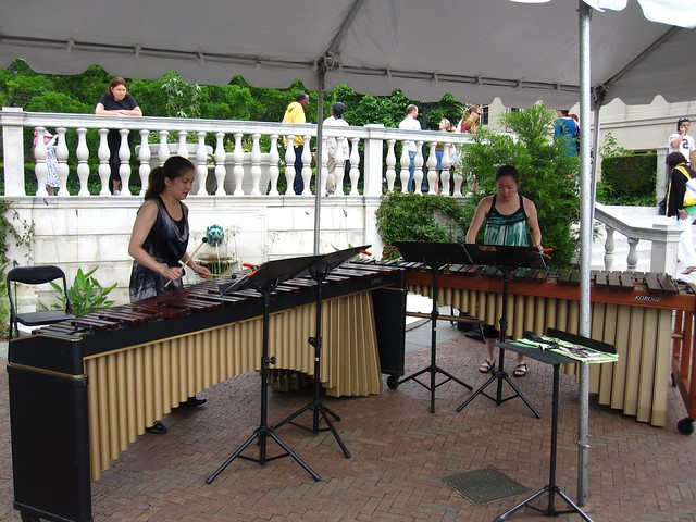 "Hiten Marimba Duo play ""Flight of the Bumblebee"" and other tunes in Lily Pool Terrace. Photo by Rebecca Bullene."