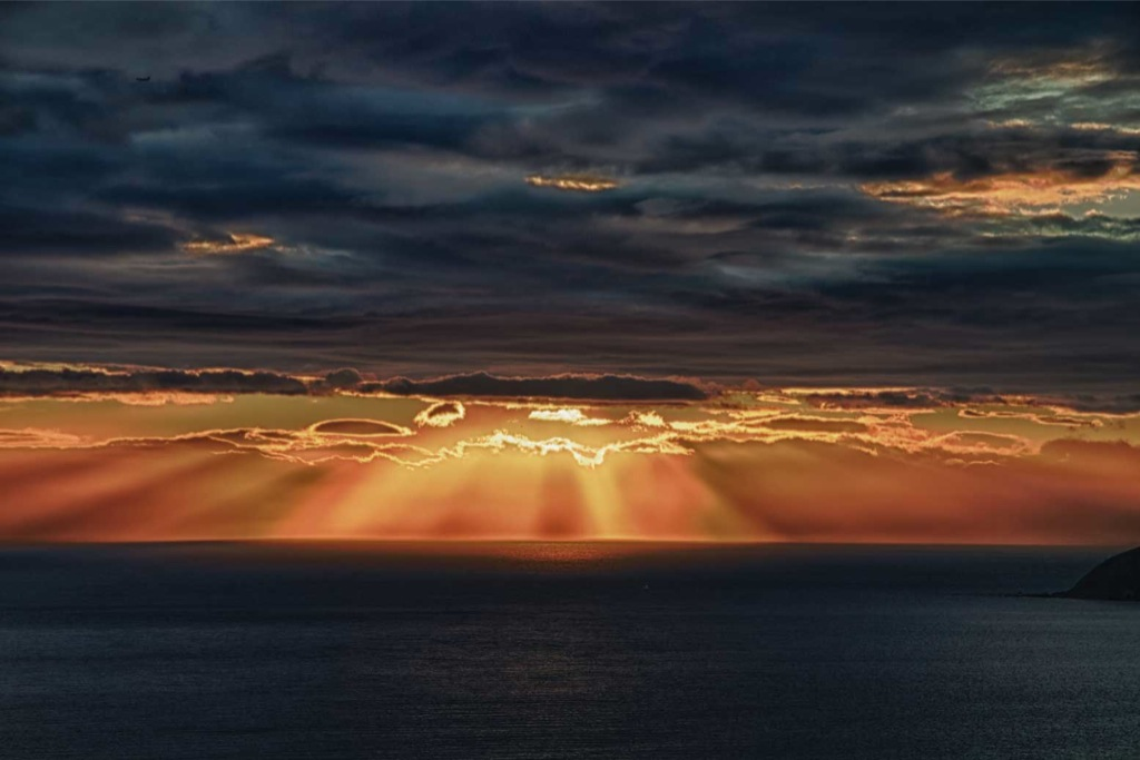 Sun rays over the sea