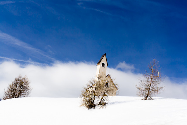 leaning church in snow