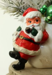 snowman(0.0), garden gnome(1.0), red(1.0), christmas decoration(1.0), santa claus(1.0), figurine(1.0), christmas(1.0), statue(1.0), toy(1.0),