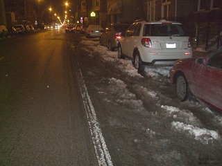 Snow in the bike lane forces bikers in the main lane