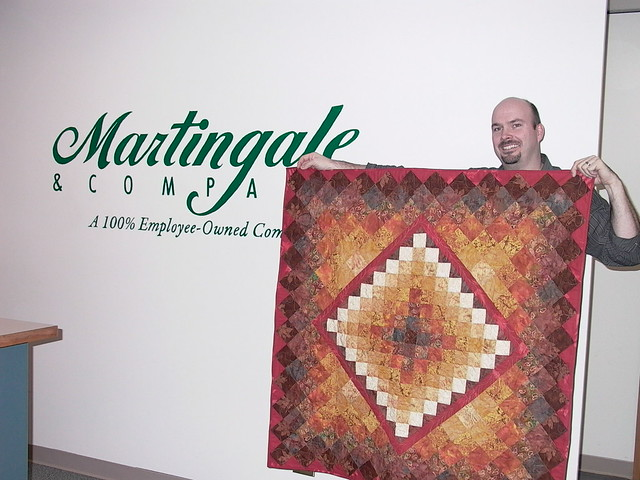 Chad with his anniversary quilt