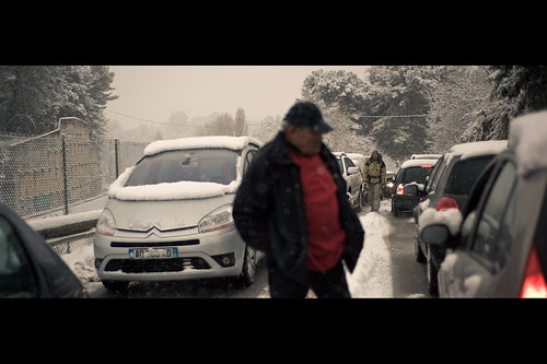 snow storm man france 50mm nikon candid walker hitchhiker f18 cinematic persepctive mougin d700 fabricedrevon