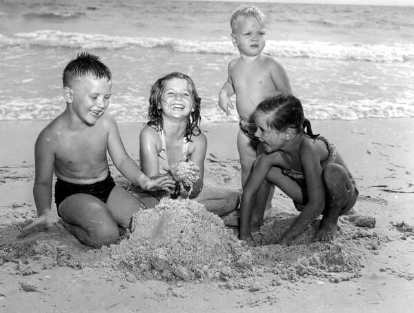 Children playing in the sand at Lido Beach: Sarasota, Florida
