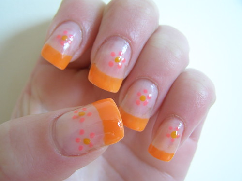 Nail art - bright orange tips with pink flower