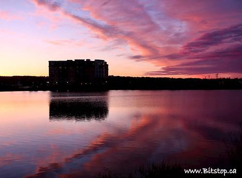 city pink sunset sky reflection building water clouds newfoundland geotagged evening twilight pond purple dusk pastel stjohns nfld kennyspond geo:lat=4759118 geo:lon=52715675