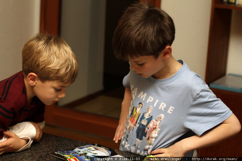 erik and nick confer over a lego catalog