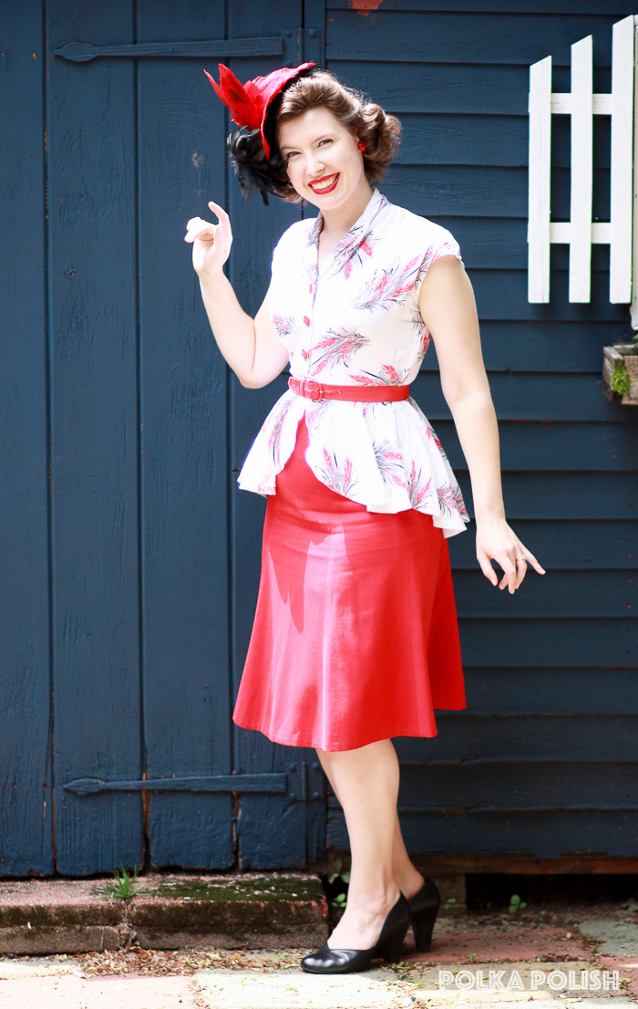 Vintage red and black wheat novelty print peplum top with a red 1940s skirt and vintage feathered tilt hat