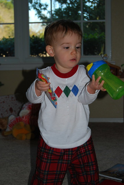 Baby P checking out his stocking stuffers