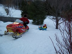 auto racing(0.0), tubing(0.0), motorsport(0.0), racing(1.0), winter sport(1.0), winter(1.0), vehicle(1.0), sports(1.0), snow(1.0), snowmobile(1.0), land vehicle(1.0), sled(1.0),