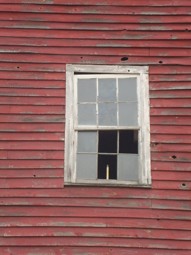 Barn window with candle