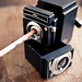 Twin lens pencil sharpener