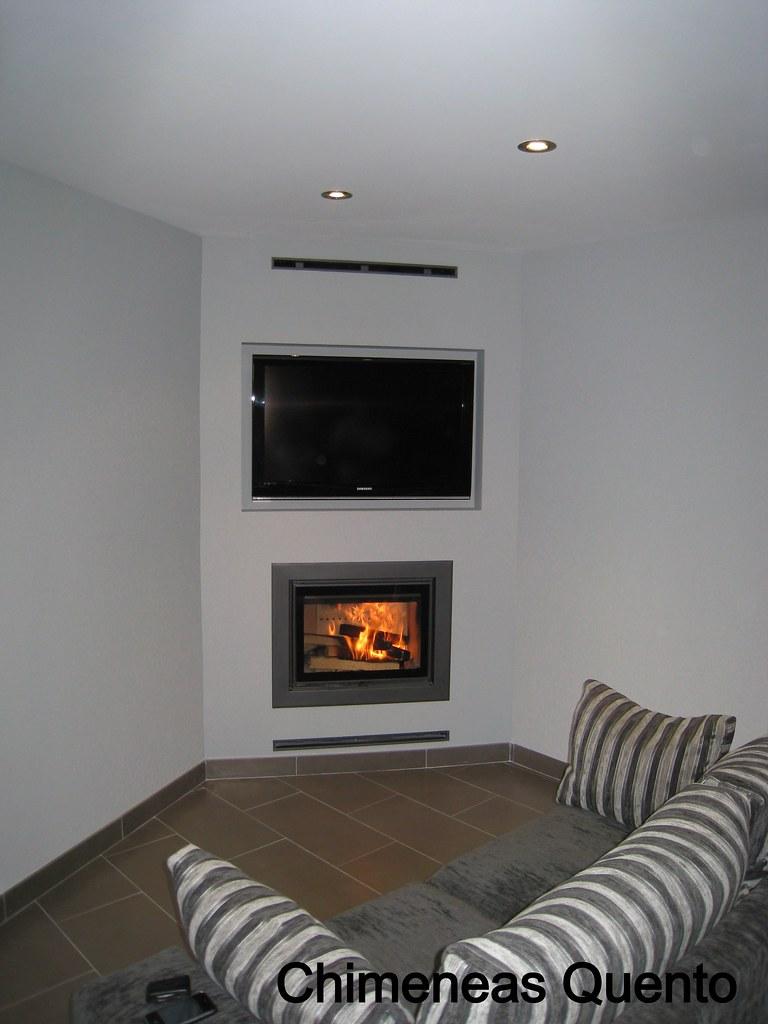 chimenea quento en esquina integrando television con hogar dovre