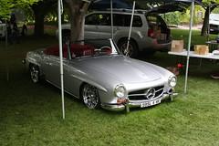 automobile(1.0), vehicle(1.0), performance car(1.0), automotive design(1.0), mercedes-benz(1.0), mercedes-benz 190sl(1.0), mercedes-benz 300sl(1.0), antique car(1.0), classic car(1.0), vintage car(1.0), land vehicle(1.0), luxury vehicle(1.0), convertible(1.0), sports car(1.0),