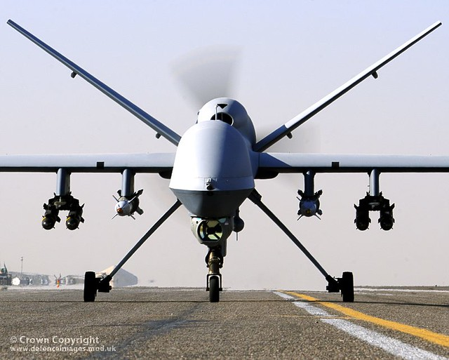 An armed British Reaper UAV taxis on the runway at Kandahar Airfield in Afghanistan.