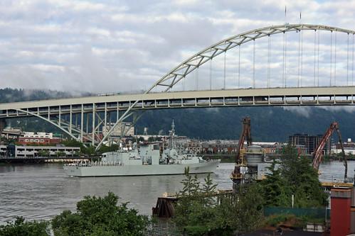 HMCS Vancouver, FFH 331, a Halifax class Frigate, leaves Portland under the Fremont Bridge. Portland Oregon, June 7 2010.