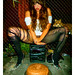 Domonique - Sits M Style on a Speakerless Stereo in Ripped Tights Behind an O Shaped Chocolate Cake In Front of Rusty Scissors Hanging on a Chain Link Fence & a Fox Coming in for a Look by merkley???