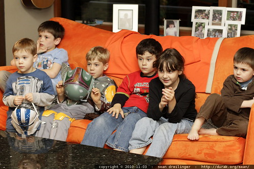 kids watching a movie at the party