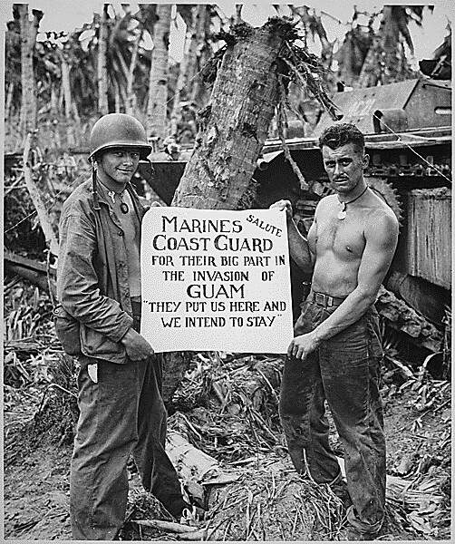 "The U.S. Marines salute the U.S. Coast Guard after the fury of battle had subsided and the Japanese on Guam had been defeated. ""They (the Coast Guard) Put Us Here and We Intend to Stay"" is the way the Marines felt about it., ca. 08/1944."