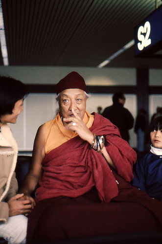 HH Dilgo Khyentse Rinpoche gestures, wearing two malas on his wrist,  chatting with Dhungsey Ani Sakya, and Dhungsey Sadu Sakya, when he visited the USA and  Dharma Center, 1976 SeaTac Airport, Seattle, Washington, USA by Wonderlane