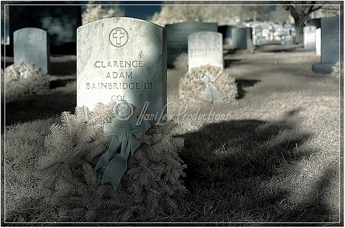 Christmas wreaths decorate headstones at Arlington National Cemetery, Virginia - an infrared image - taken with a Nikon D200 IR-converted camera and Nikon 18-200 VR lens