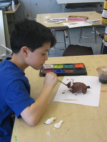Bullis student painting his Buddy Bison creation