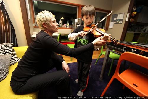 nick practices violin w/rachel
