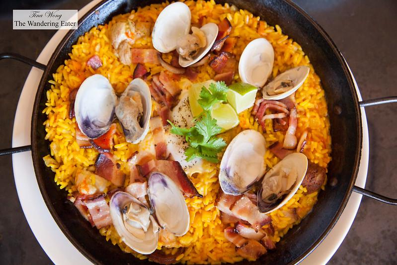 Breakfast paella with chicken, chorizo, mussels, saffron rice, baked eggs