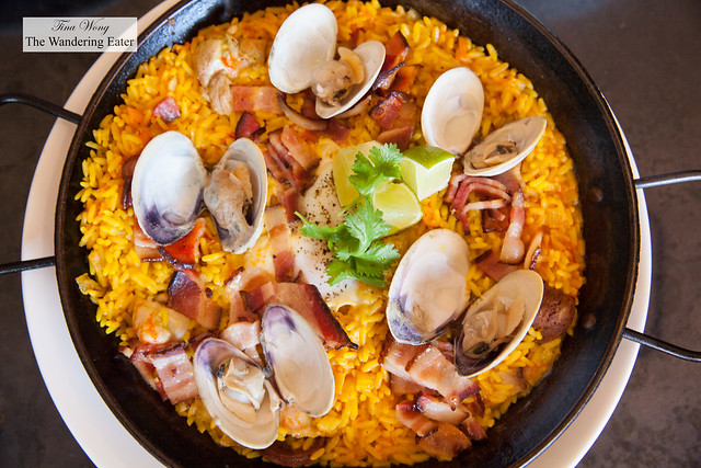 Breakfast paella with chicken, chorizo, mussels, saffron rice, baked eggs
