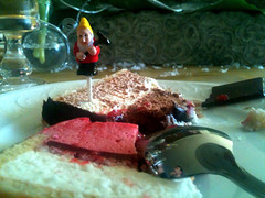 The dwarves had secured a beachhead on top of the Christmas cake. We panicked.
